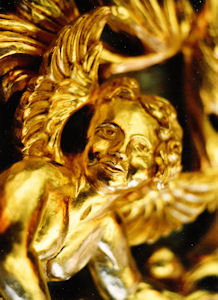 Close up of carved angel face, Cherub for ASU, carved wood sculpture
