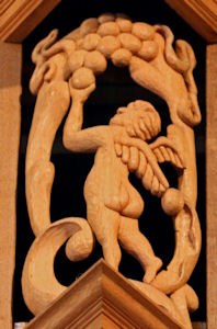 Carved wood sculpture, cherub figure, Episcopal Church of the Ascension, Seattle, WA