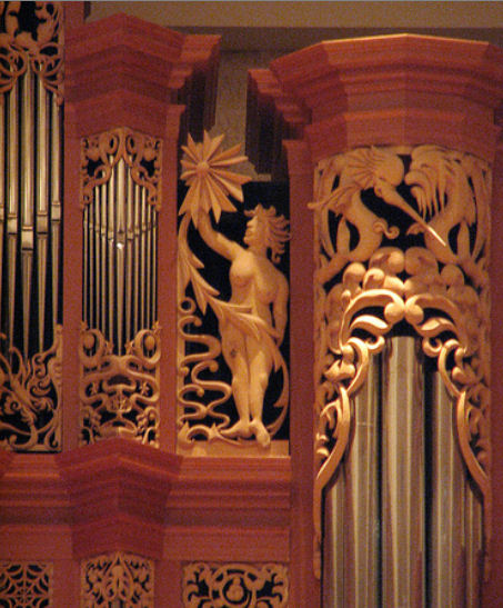 Carved sculpture of woman with sun and sea creatures, carvings for the organ at the Gottfried and Mary Fuchs Organ, Pacific Lutheran University, Tacoma Washington, wood carver Jude Fritts
