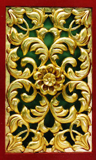 Gold leafed flower in wood panel for Arizona State University, Tempe
