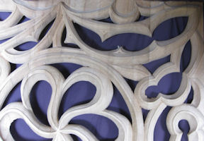Abstract design of loaves and fishes, wood carved gothic tracery, Saint Philip Presbyterian Church, Houston TX