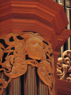 Carved faces in wood sculpture for the Gottfried and Mary Fuchs Organ, Pacific Lutheran University, Tacoma Washington, wood carver Jude Fritts